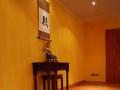 Qigong_Taichi_Yoga-Studio - Tao Institut - Dortmund, Raum-Kopf-mitBuddha-und-Schriftrolle